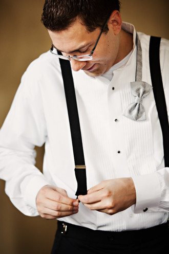 Groom's Preparation Attaching Suspenders